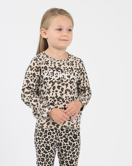 Photo of the Redhead Little Babes classic crew neck sweatshirt in leopard by Brunette the Label.