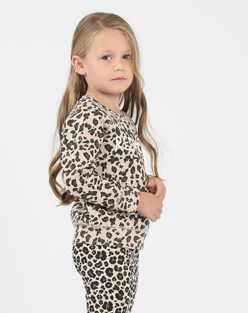 Photo of the side of the Redhead Little Babes classic crew neck sweatshirt in leopard by Brunette the Label.