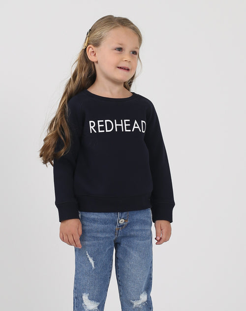 Photo of the Redhead Little Babes classic crew neck sweatshirt in navy by Brunette the Label.