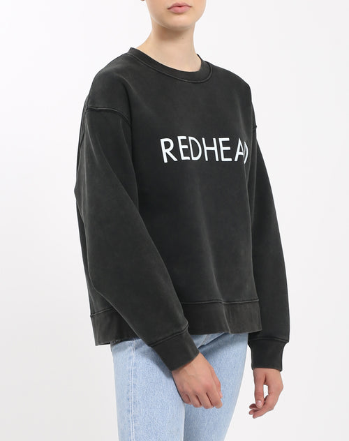 Side view photo of the Redhead Step Sister crew neck sweatshirt in acid wash by Brunette the Label.