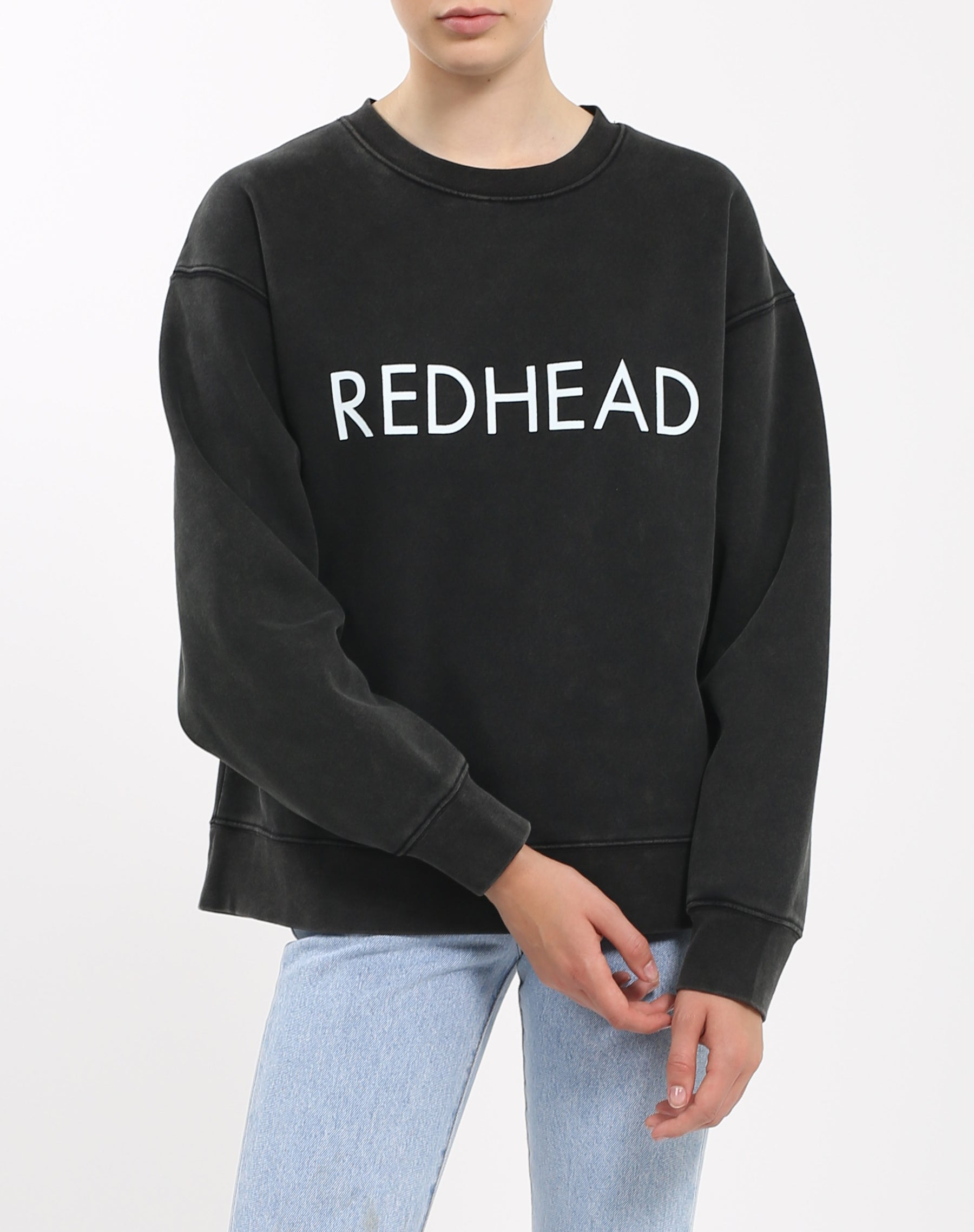 Photo of the Redhead Step Sister crew neck sweatshirt in acid wash by Brunette the Label.