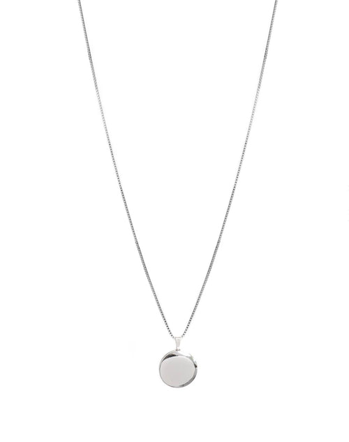 Image of the Round Locket in silver by Lisbeth.