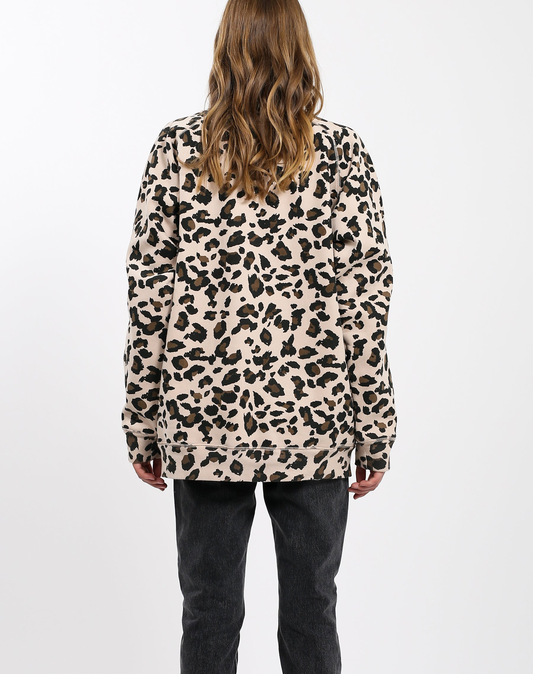 Photo of the back of the Uplift All Babes big sister crew neck sweatshirt in leopard by Brunette the Label.