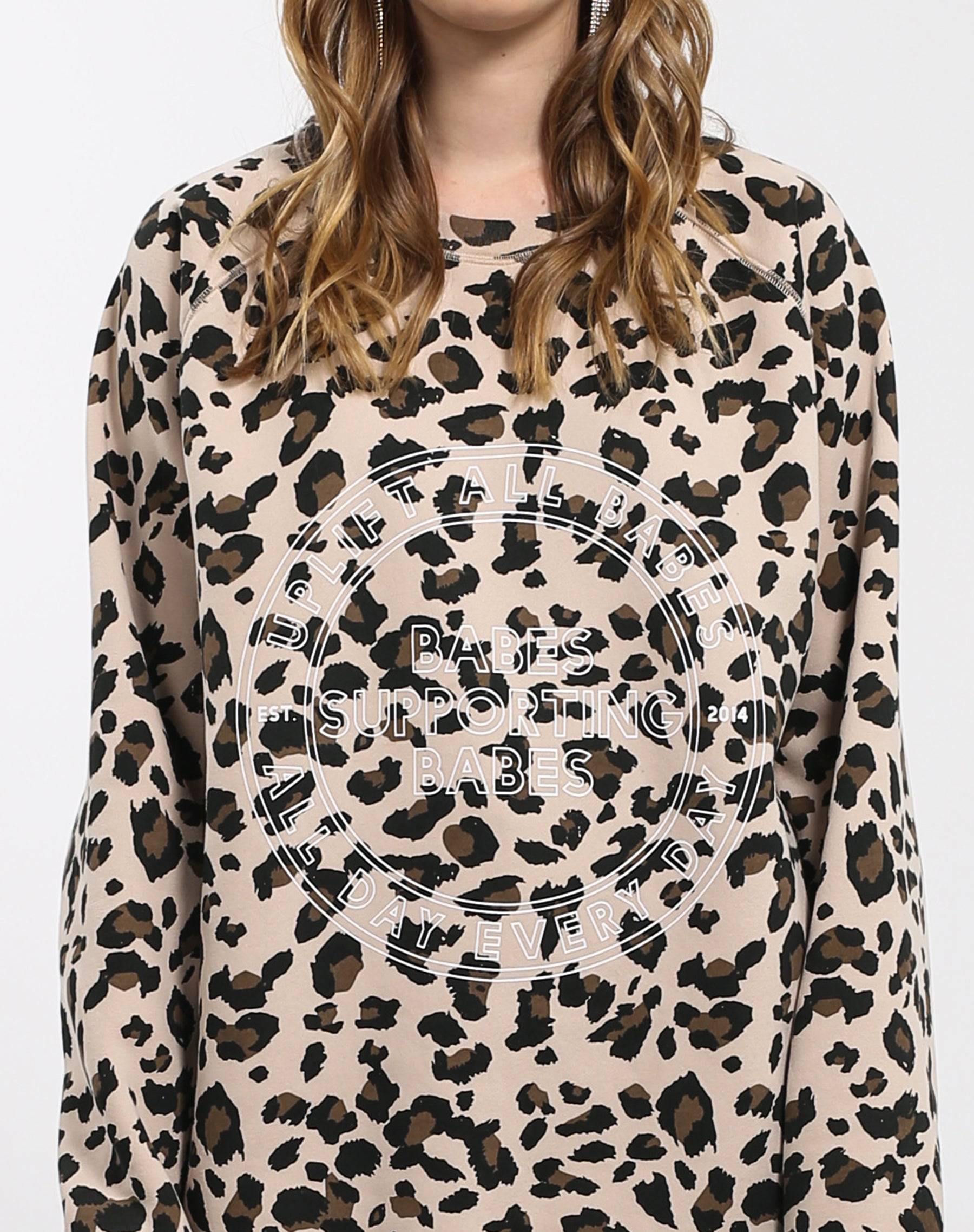 Close up photo of the Uplift All Babes big sister crew neck sweatshirt in leopard by Brunette the Label.