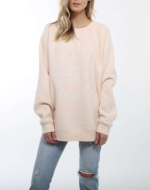 Photo 2 of the Uplift All Babes big sister crew neck sweatshirt in peach crush by Brunette the Label.