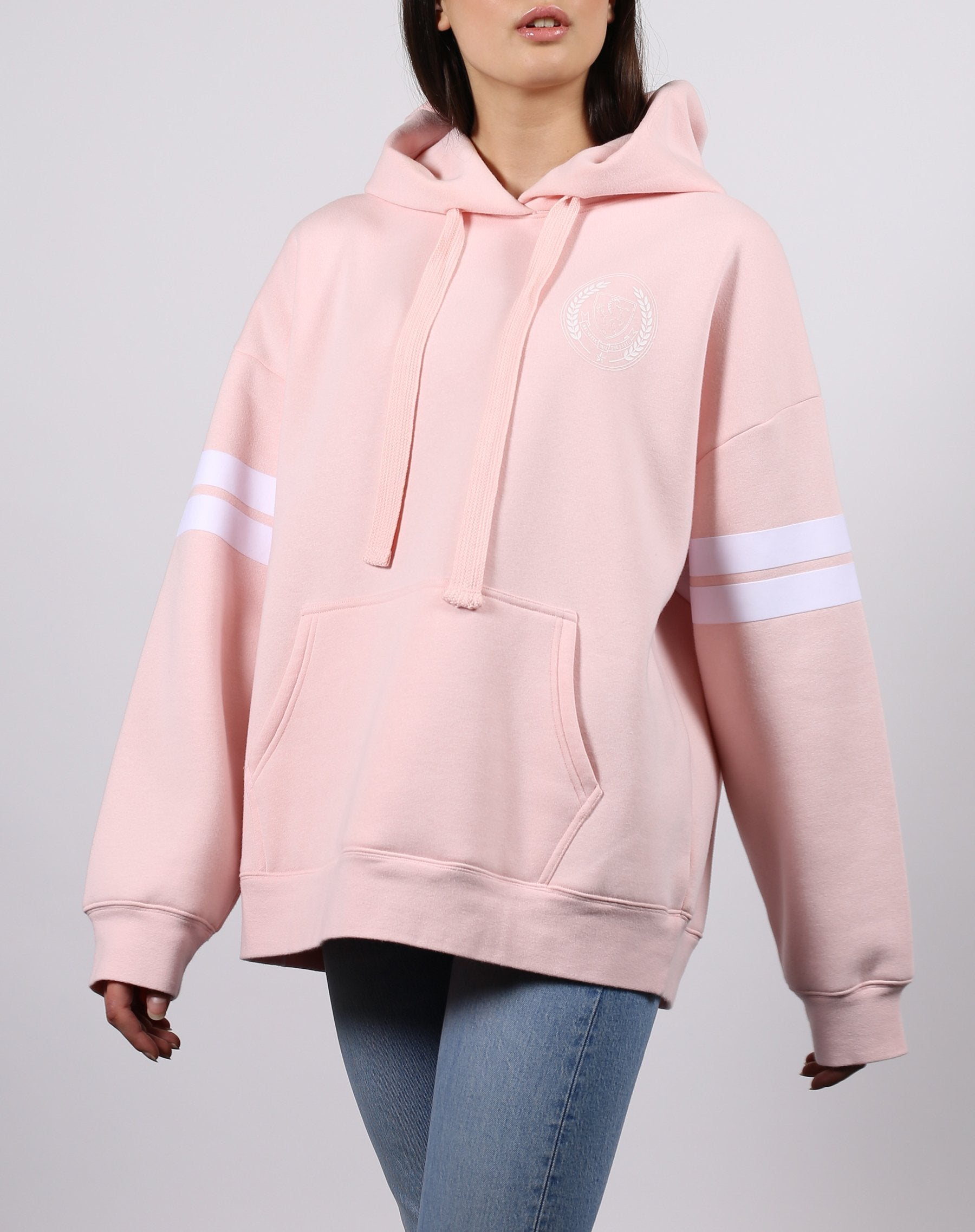 This is a photo of the front of the equestrian crest big sister hoodie in ballet slipper from brunette the label