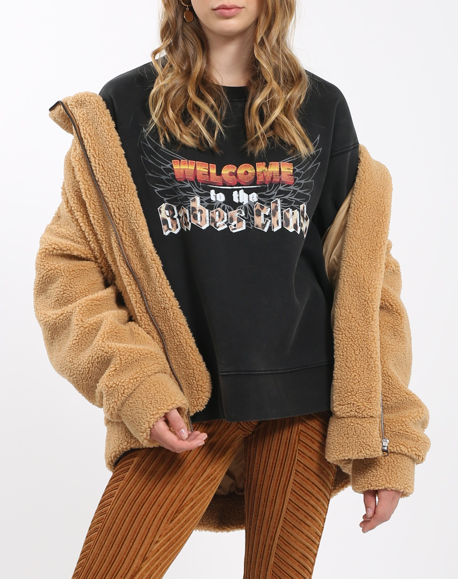 Photo 2 of the Welcome to the Babes Club step sister crew neck sweatshirt from The 1981 Collection by Brunette the Label.
