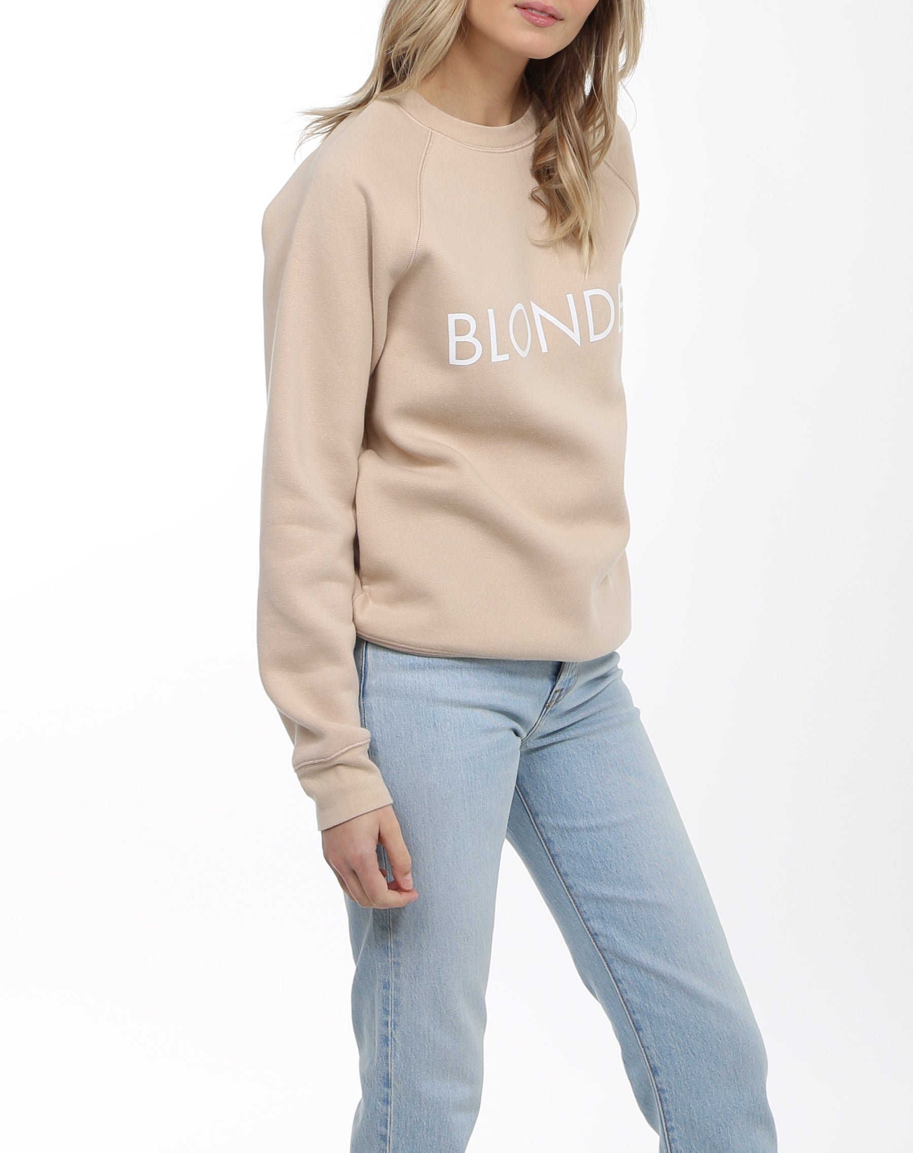 Side photo of the Blonde classic crew neck sweatshirt in toasted almond by Brunette the Label.
