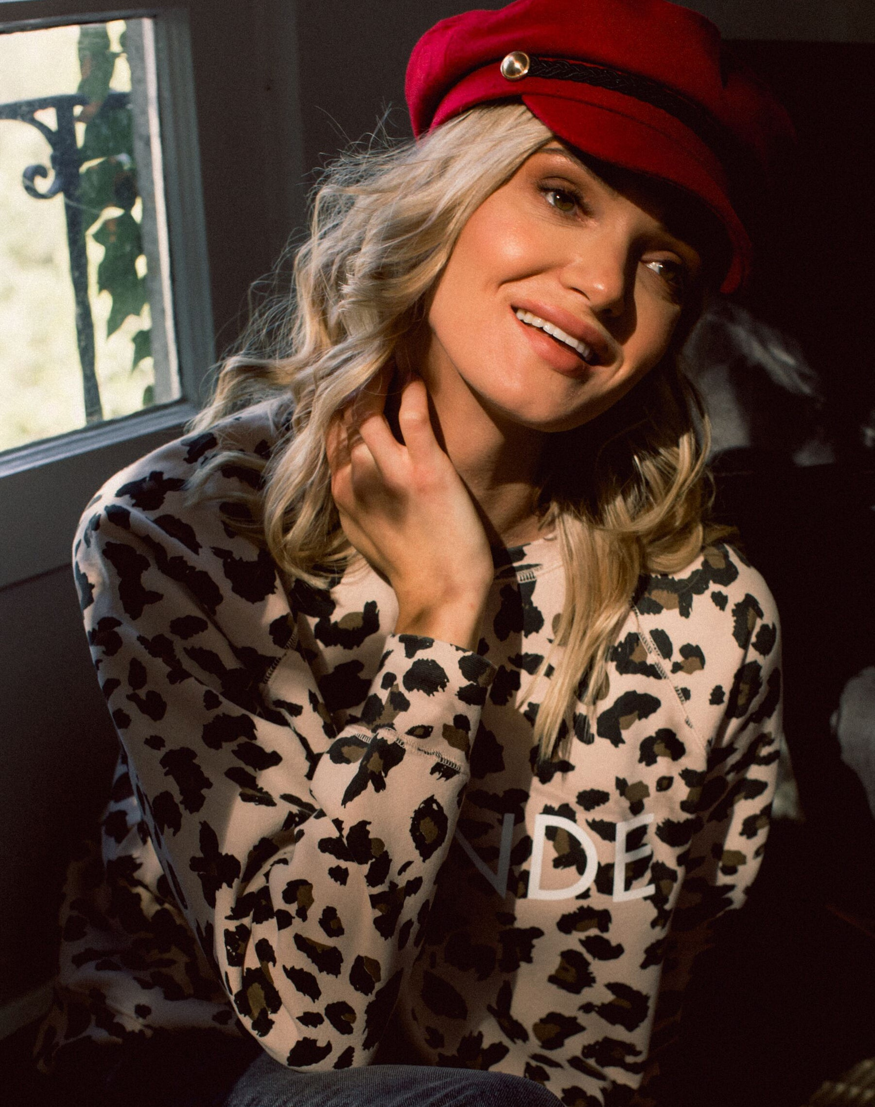 Photo 2 of the Blonde middle sister crew neck sweatshirt in leopard print by Brunette the Label.