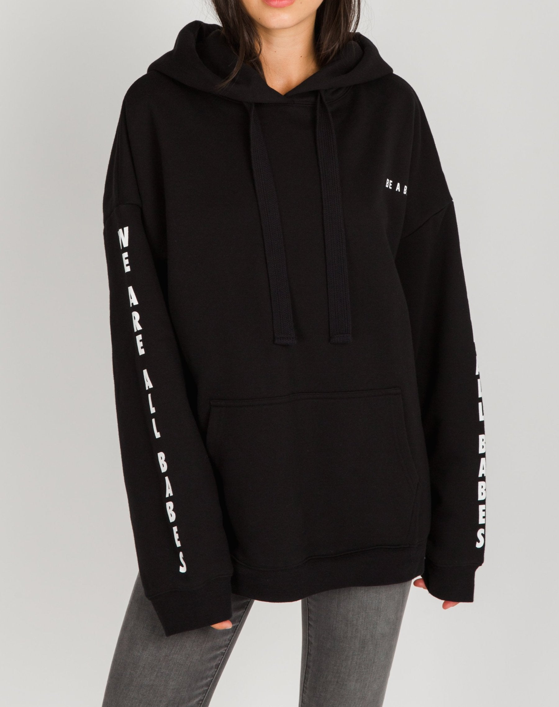 Photo of the Be a Babe big sister hoodie in black by Brunette the Label.