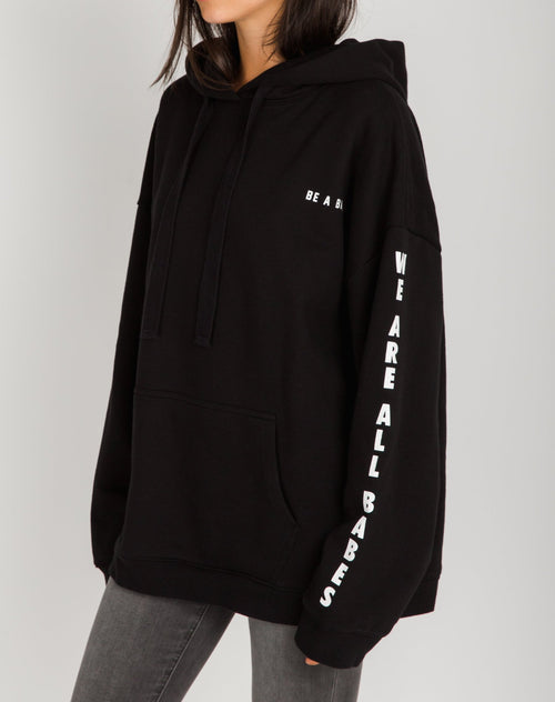 Photo 2 of the Be a Babe big sister hoodie in black by Brunette the Label.