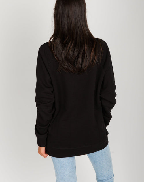 Photo of the back of the Pinot Please classic crew neck sweatshirt in black by Brunette the Label.