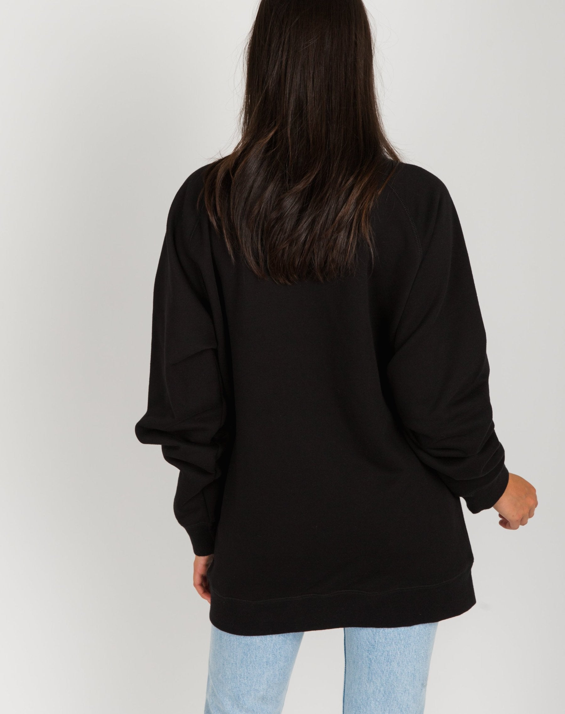 Photo of the back of the Redhead big sister crew neck sweatshirt in black by Brunette the Label.
