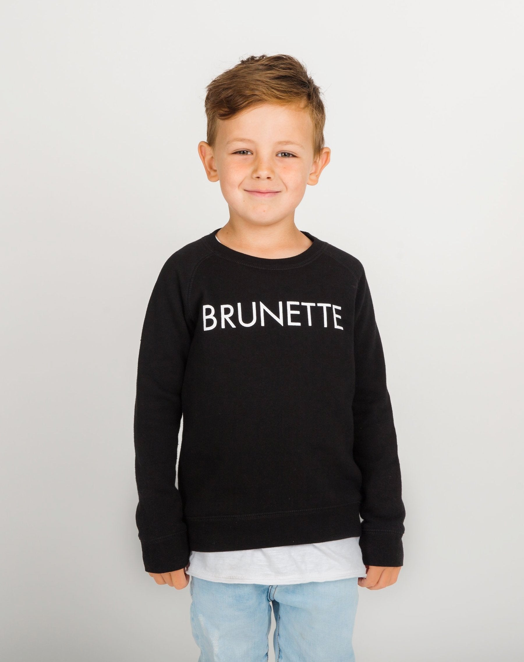 Photo of the Brunette Little Babes classic crew neck sweatshirt in black by Brunette the Label.