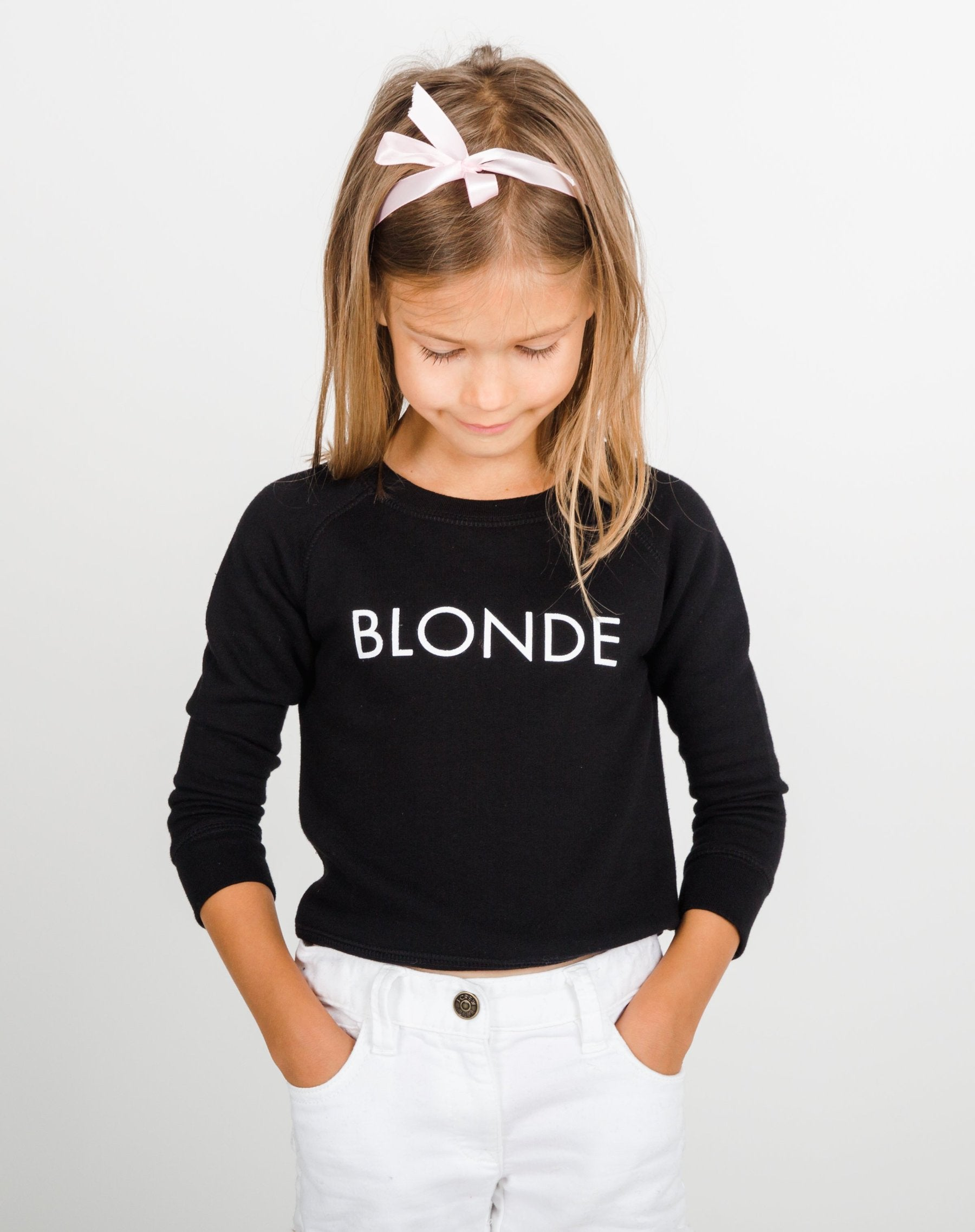 Photo 2 of the Blonde Little Babes classic crew neck sweatshirt in black by Brunette the Label.