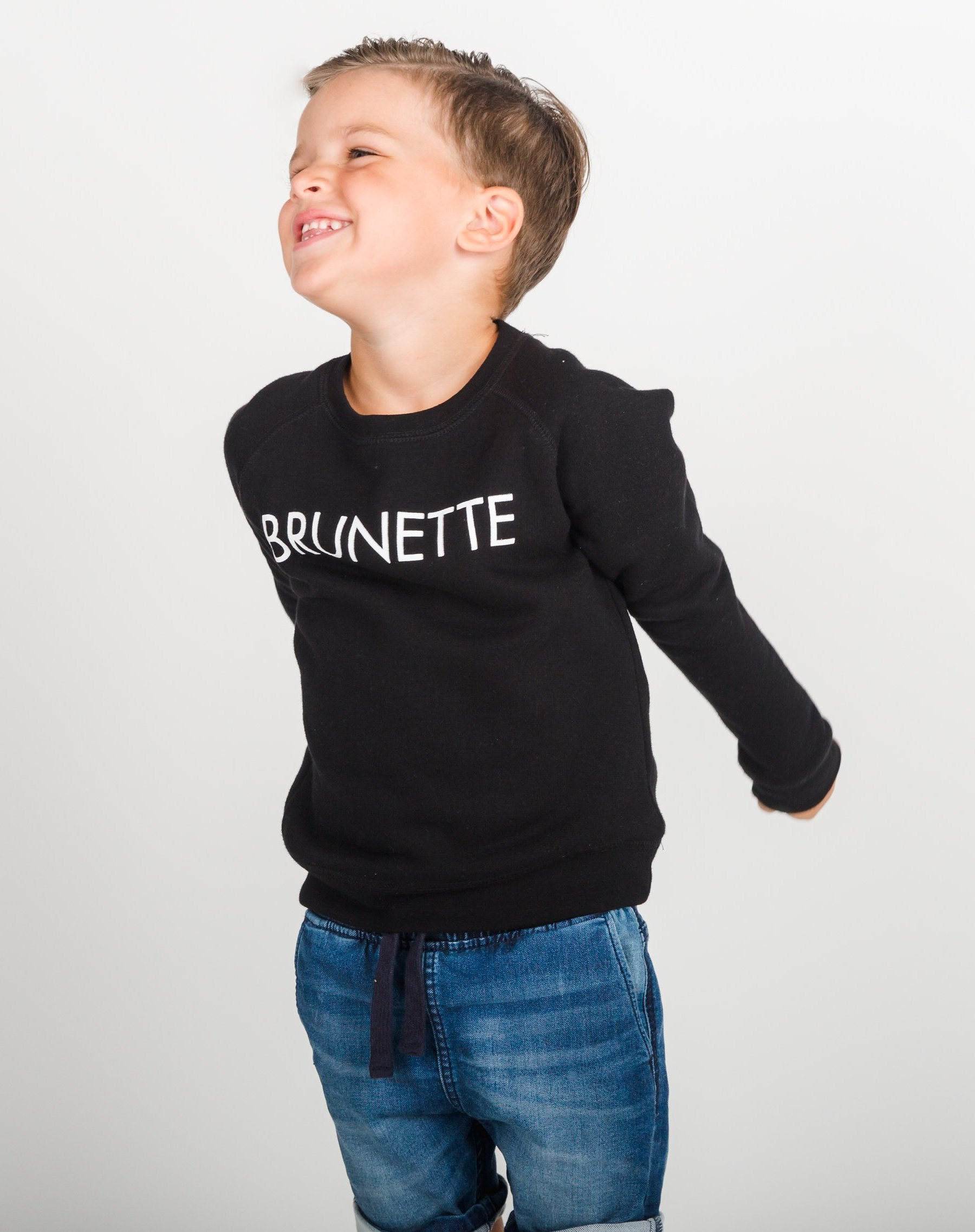 Photo 2 of the Brunette Little Babes classic crew neck sweatshirt in black by Brunette the Label.