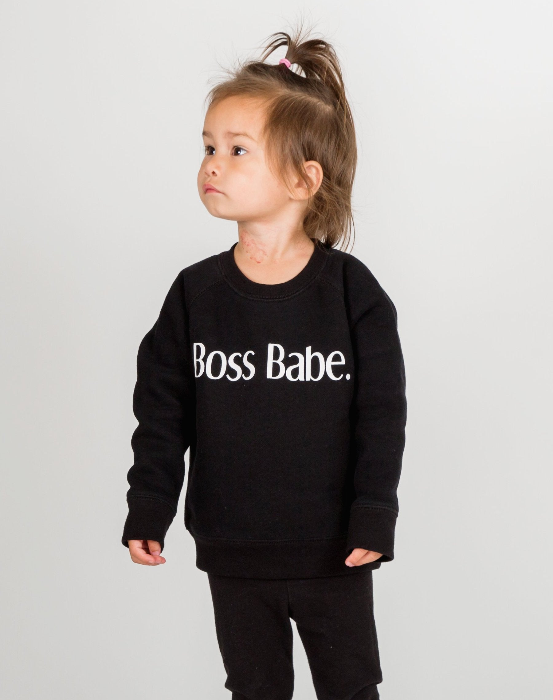 Photo of child wearing Boss Babe classic crew neck sweatshirt in black by Brunette the Label.