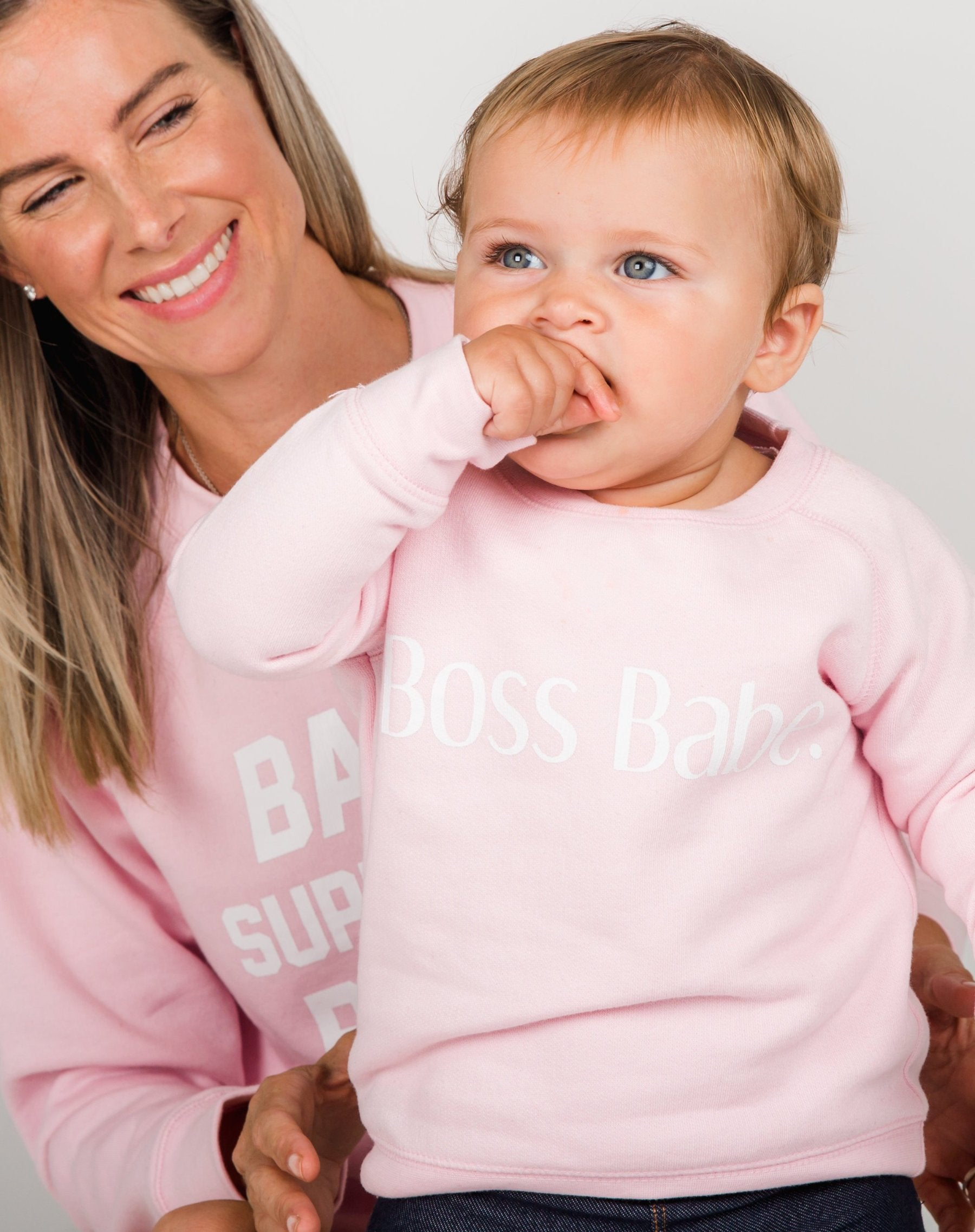 Photo 2 of child wearing the Boss Babes classic crew neck sweatshirt in pretty pink by Brunette the Label.