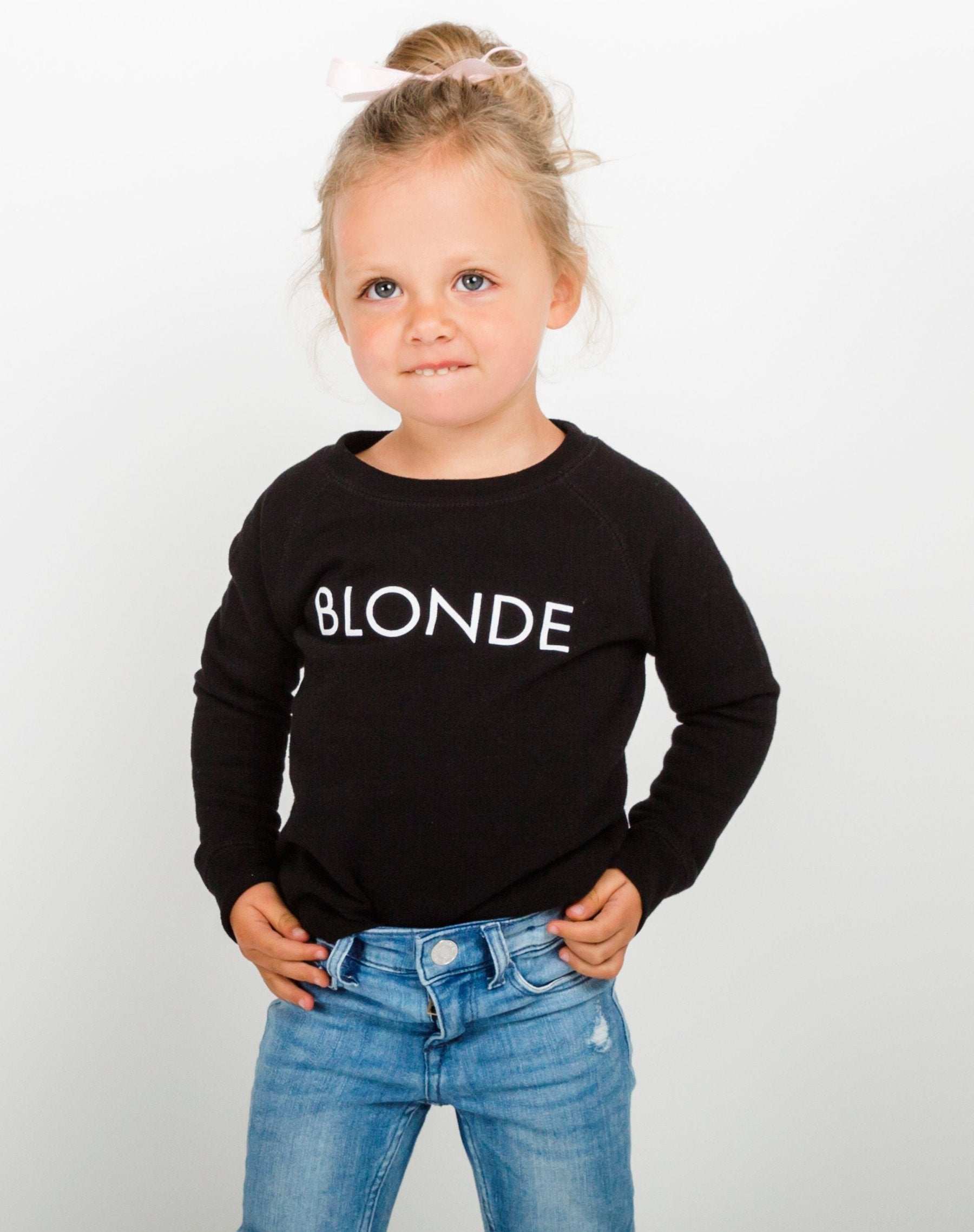 Photo of the Blonde Little Babes classic crew neck sweatshirt in black by Brunette the Label.