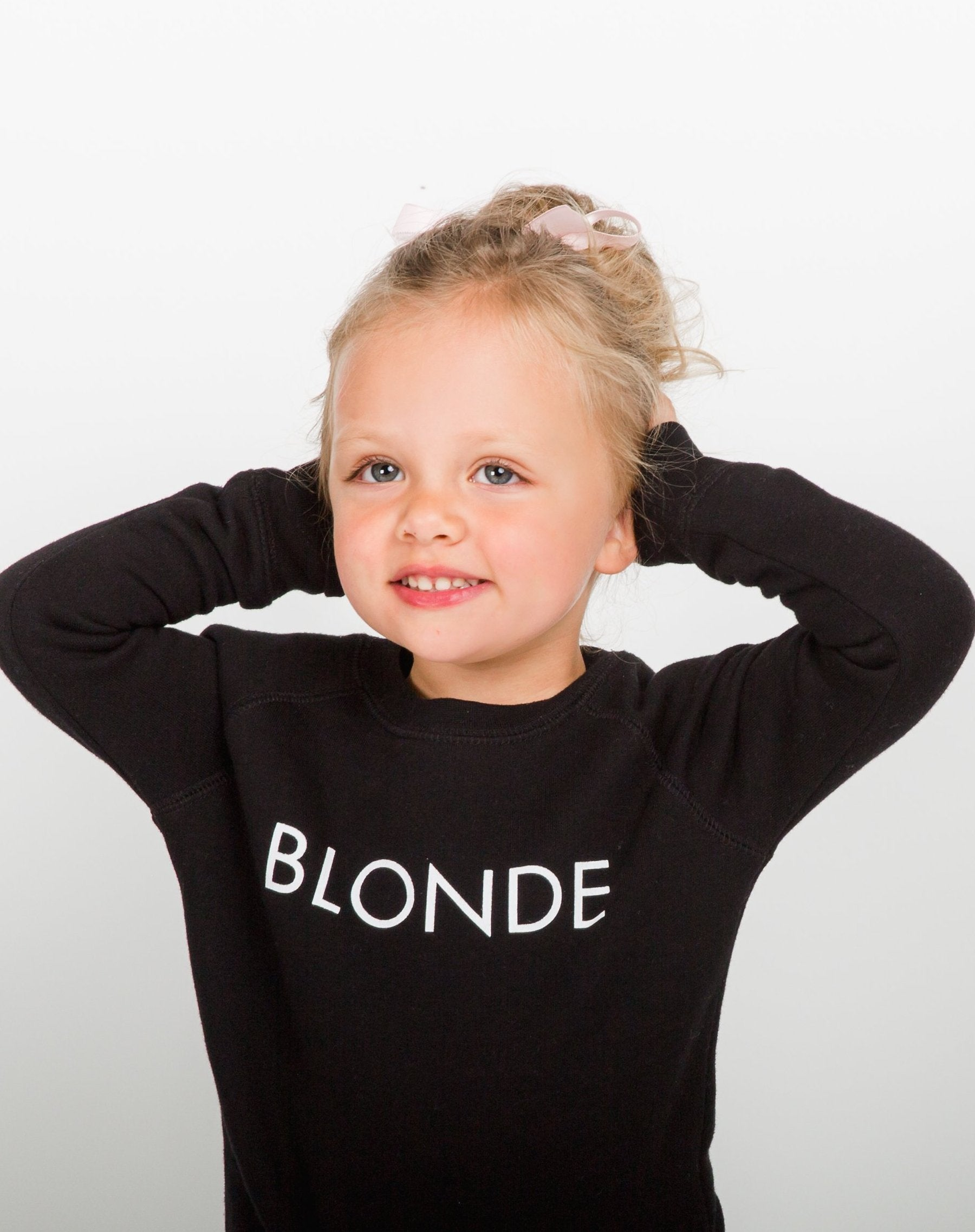 Photo 3 of the Blonde Little Babes classic crew neck sweatshirt in black by Brunette the Label.