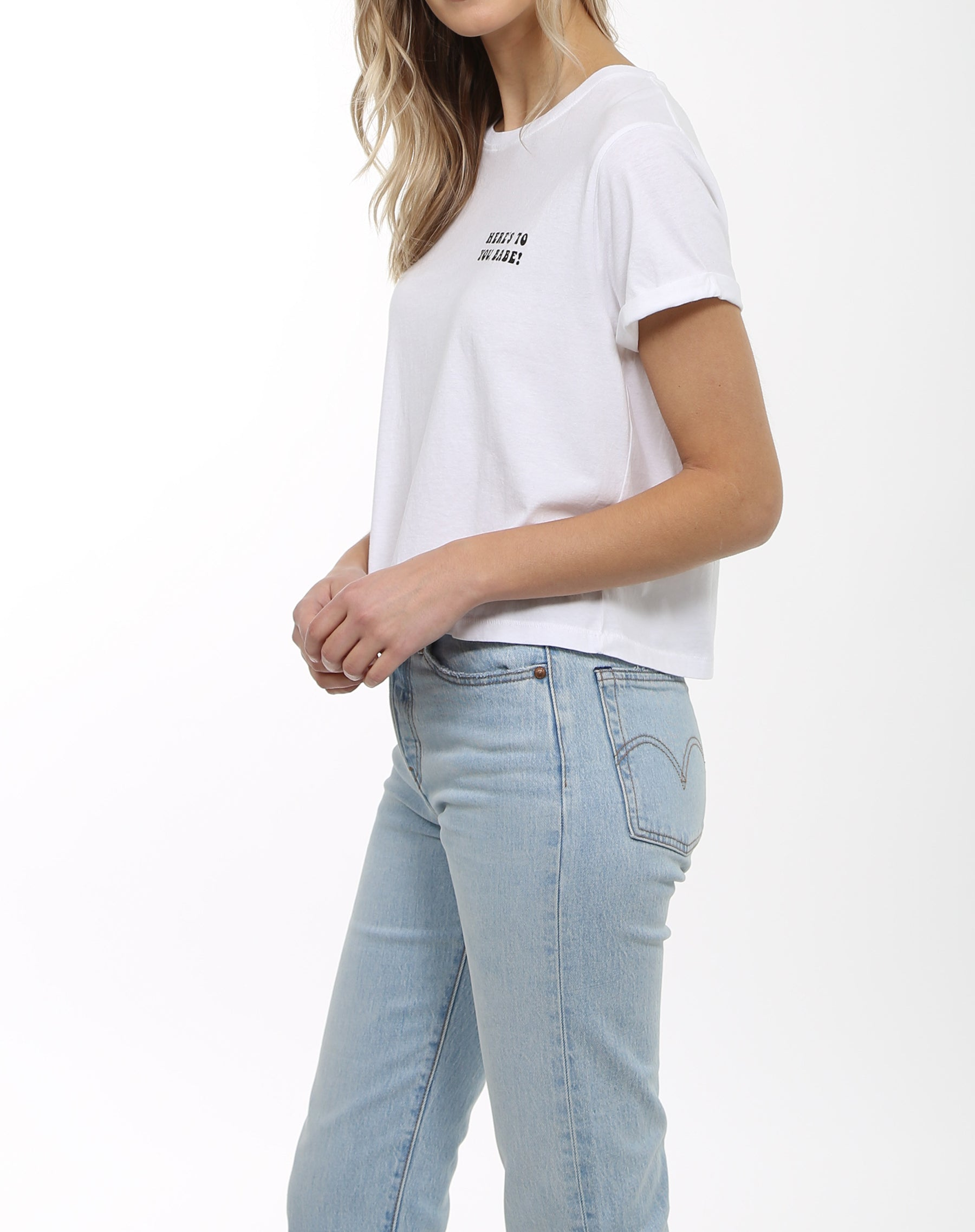 Side photo of the Here's to You Babe crew neck tee in white by Brunette the Label.