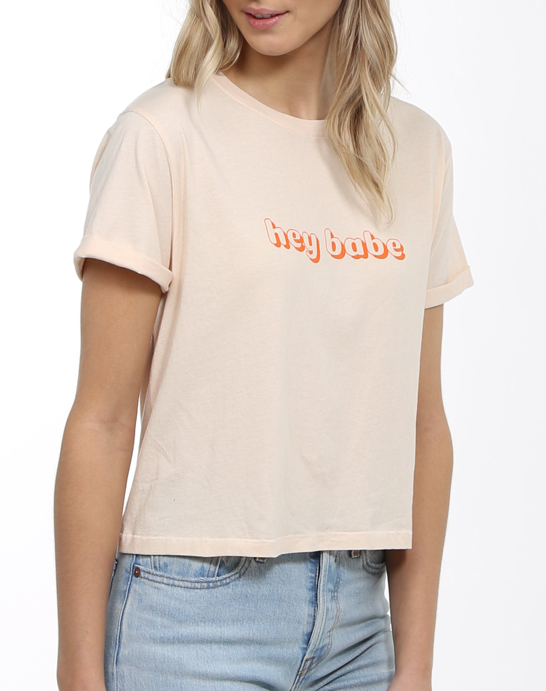 Close up photo of the Hey Babe cropped crew neck tee in peach crush by Brunette the Label.