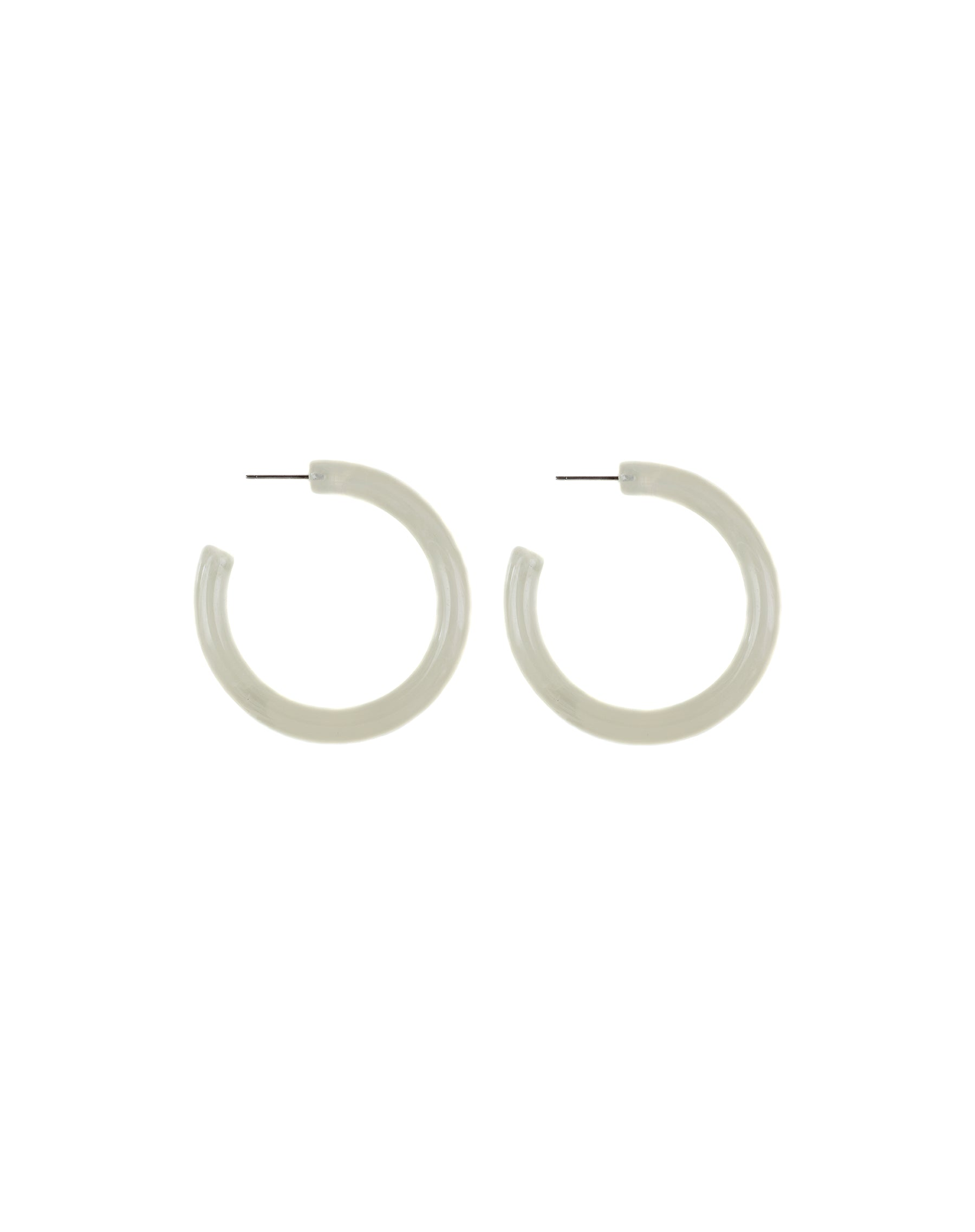 Photo of the Jeanne hoops in lucite by Lisbeth.