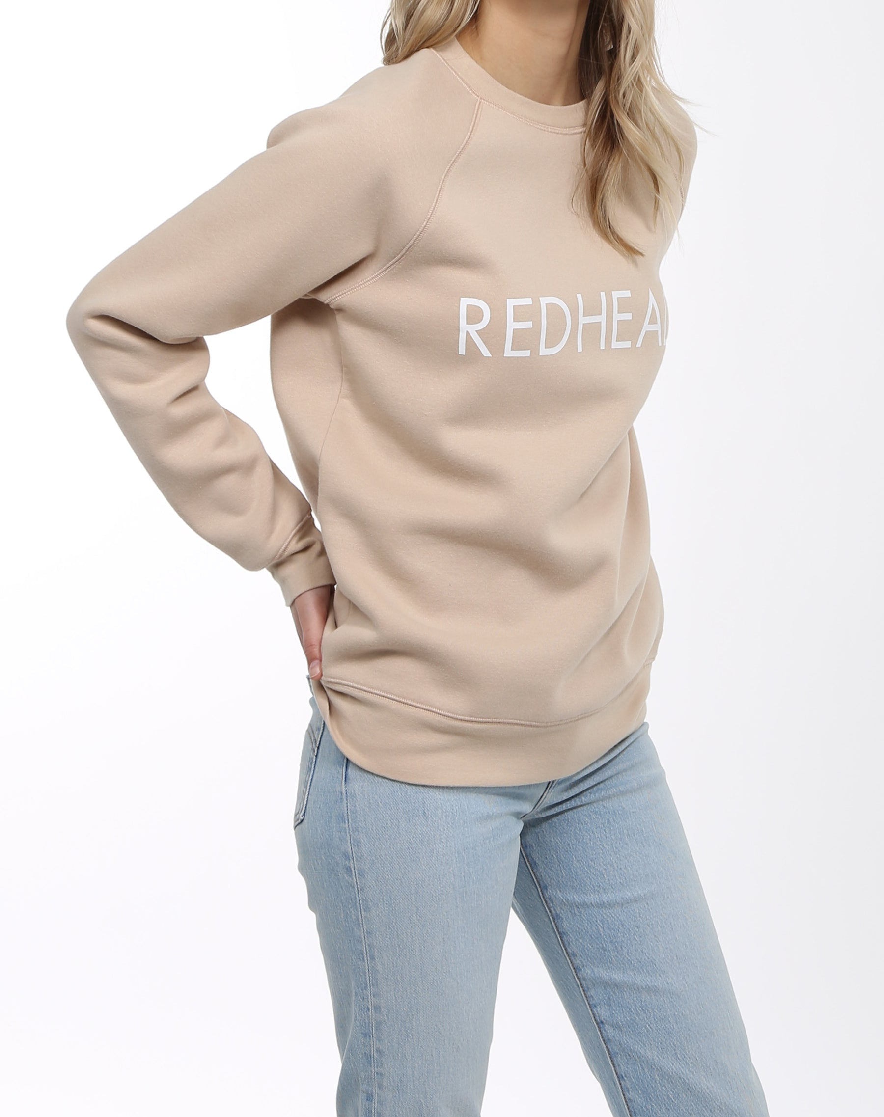 Side photo of the Redhead classic crew neck sweatshirt in toasted almond by Brunette the label.