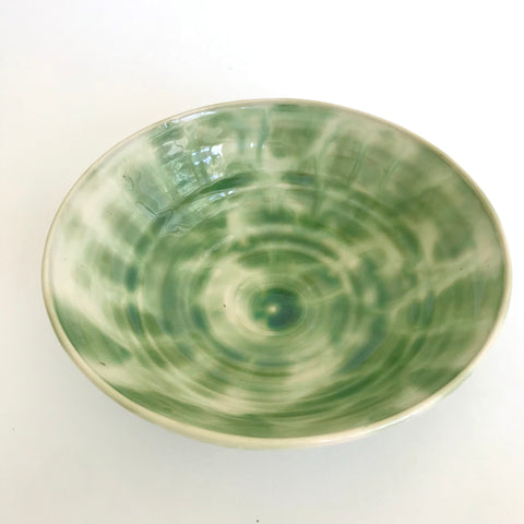 Bowl with feathered, leafy green pattern