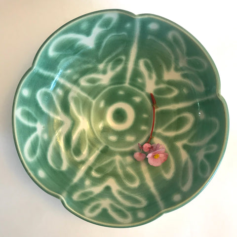 Patterned green and white serving bowl