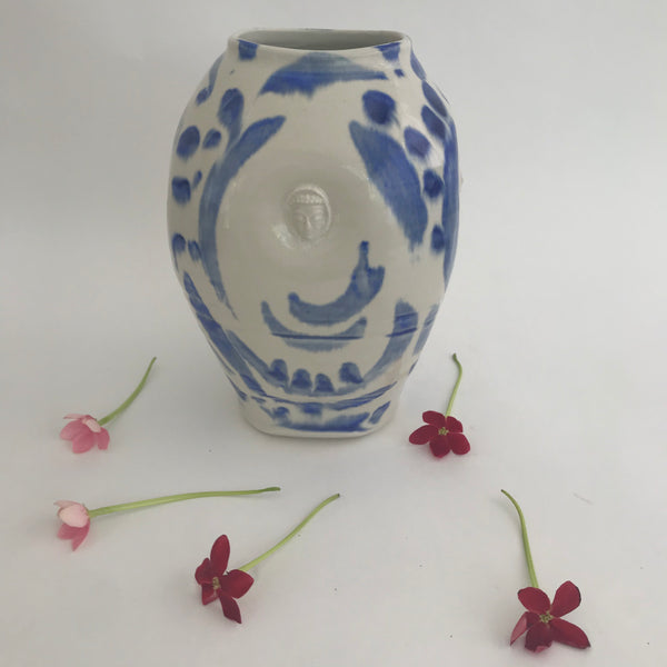 Squared off classic vase with loose cobalt brushwork and Buddha faces