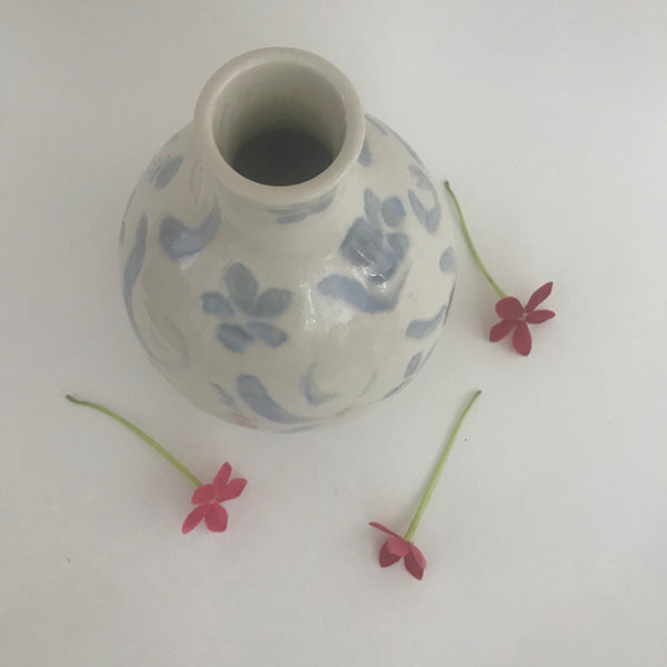 Light blue and white porcelain bud vase with brushwork