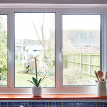 Load image into Gallery viewer, White Locking Aluminium Window Handle shown on White Aluminium Windows