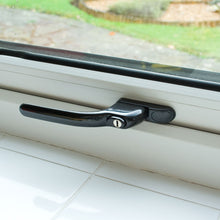 Load image into Gallery viewer, Black uPVC Casement Window Locking Handle on White uPVC window, buy now at Anglian Home Improvements