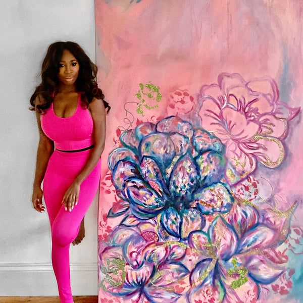 Lauren Rogers-Martin standing next to her Pink Flowers Painting