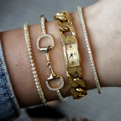 Yellow gold bracelets and Tiffany and Co. watch bracelet