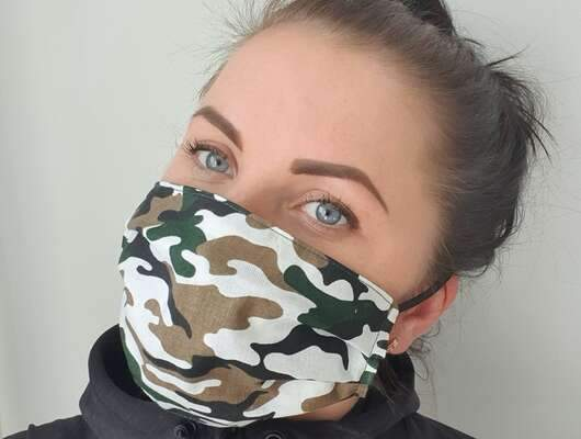 woman with cotton handmade reusable face mask face covering camouflage