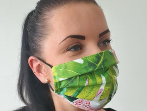 woman with cotton handmade reusable face mask face covering flamingo