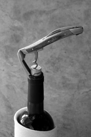 forge de laguiole corkscrew atop a bottle