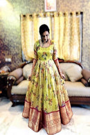 Stylish Soft Silk Lemon Green color Anarkali Flared Gown