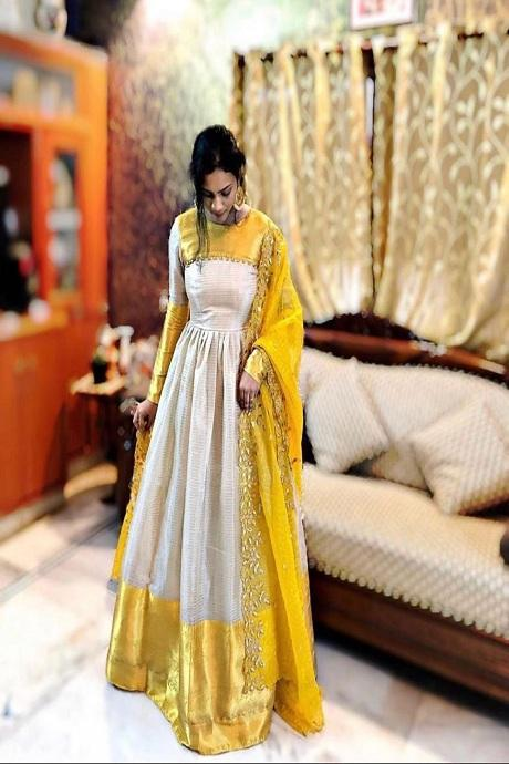 Stylish Soft Silk Creamy Silver color Anarkali Flared Gown
