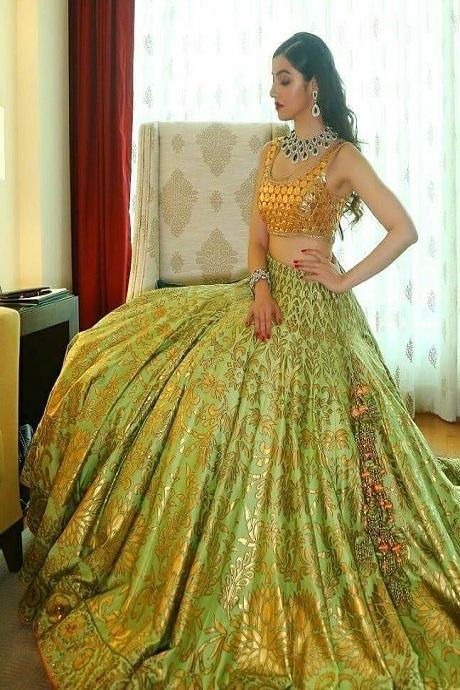 Green Heavy Embroidered Attractive Party Wear Lehenga Choli