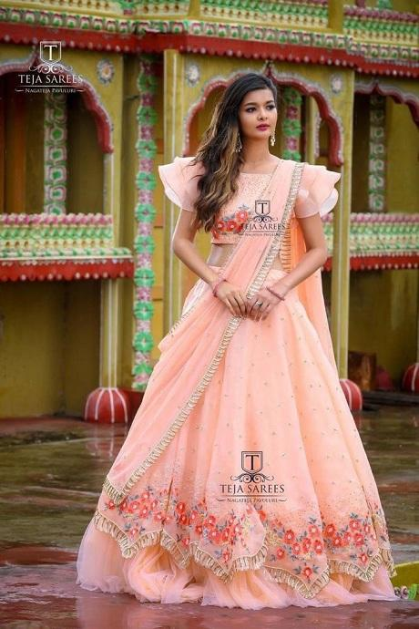 Attractive Light Orange Colored Soft Silk Lehenga Choli