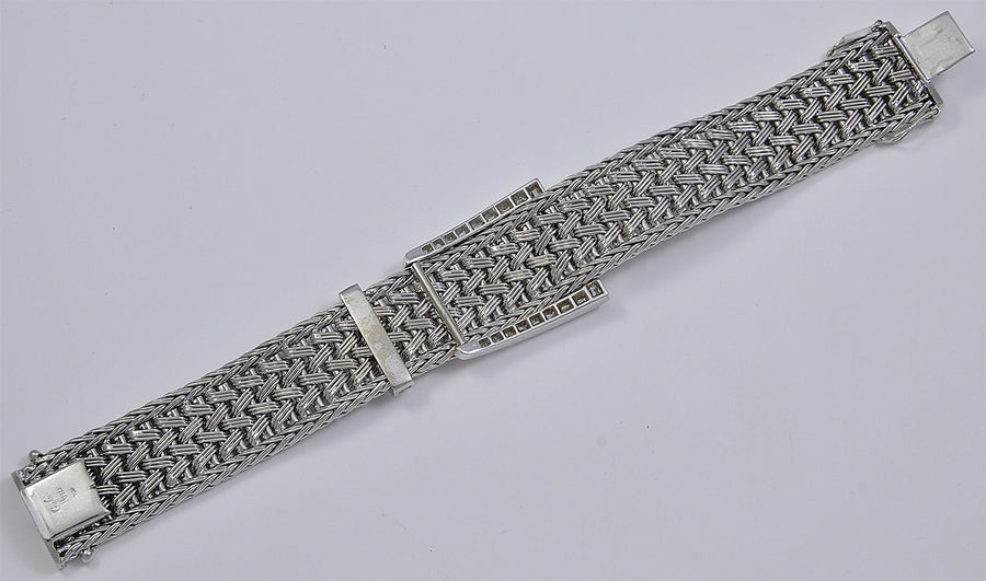 A Woven 18kt White Gold Bracelet with Baguette Diamond Fittings