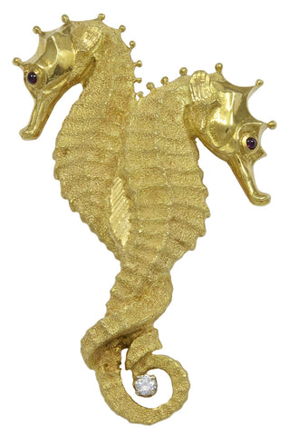 An 18kt Gold Double Seahorse Brooch