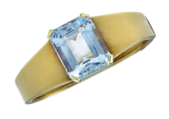 An Aquamarine and Gold Bangle of beautiful simplicity