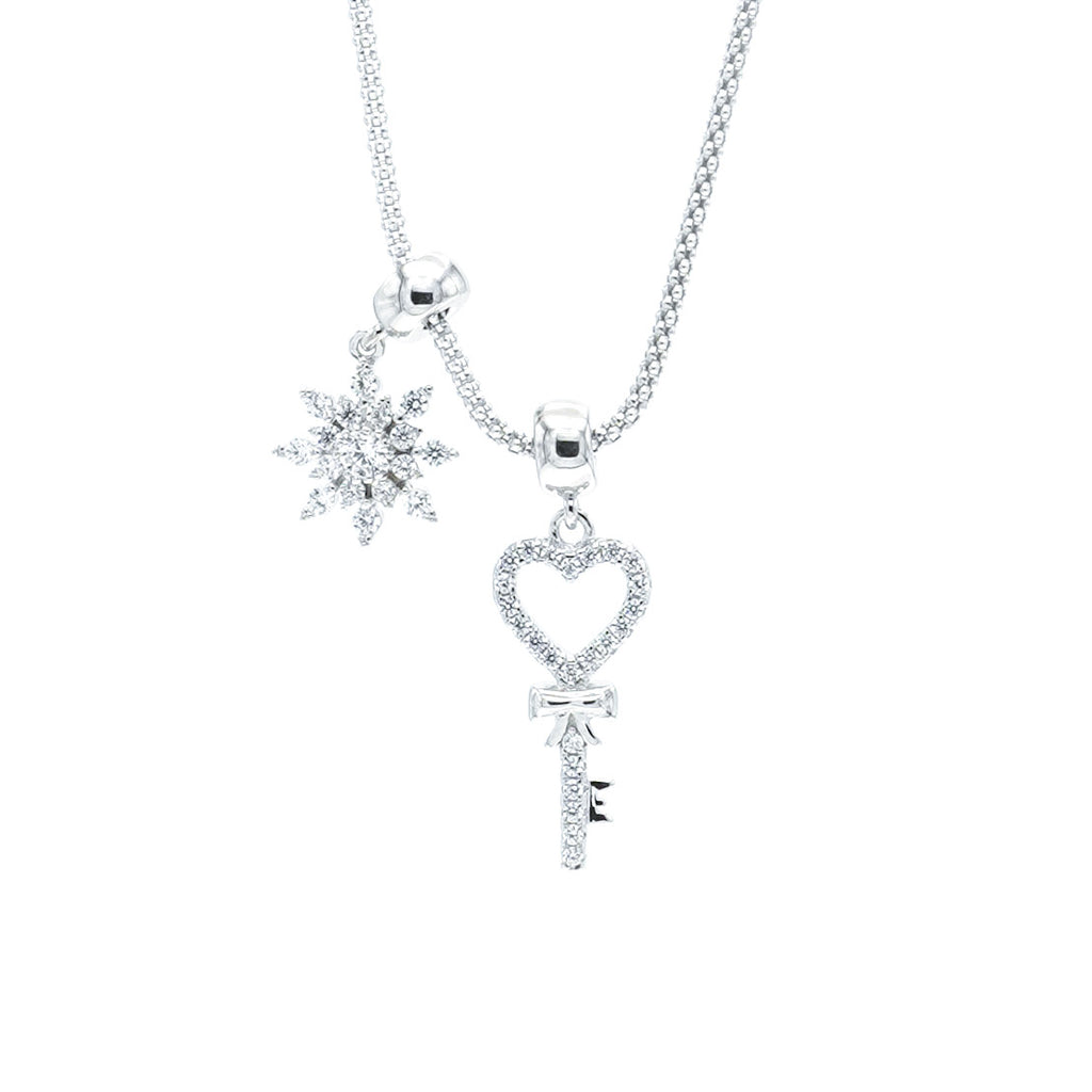 """Key to your heart"" necklace with sparkly snowflake"