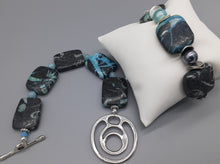 Load image into Gallery viewer, Blue and black stone bead bracelet. Stretch and clasp style blue and black stone bracelets. Nice & Pretty Jewelry handcrafted in Canada