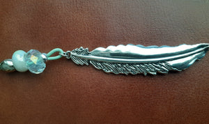 "Long silver feather pendant on leather cord. Various colors and lengths. 3.5"" feather lots of details on leather cored with bead accents. Nice & Pretty Jewelry Canada"