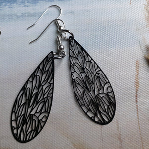 Laser cut design black dragonfly wing earrings. Dragonfly wing earrings. Black long oval earrings with patterns. Nice & Pretty Jewelry. Canada